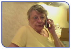 Elderly lady answering a phonecall