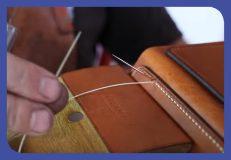 Stitching a leather handbag